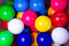 Plastic colored children`s balls. Bright round balls for children`s pools. And games stock image