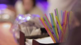 Plastic colored cocktail straws at bar stock footage