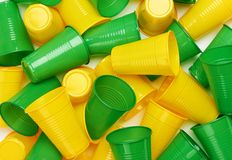 Plastic colored cup close-up. Environmental problem concept royalty free stock image