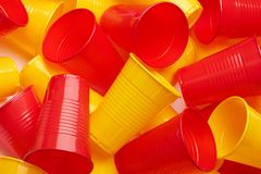 Plastic colored cup close-up. Environmental problem concept stock images