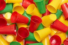 Plastic colored cup close-up. Environmental problem concept stock image