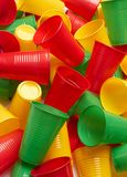 Plastic colored cup close-up. Environmental problem concept stock photo