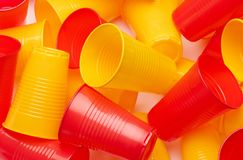 Plastic colored cup close-up. Environmental problem concept stock photography
