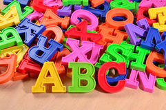Plastic colored letters ABC on a wooden background Stock Image