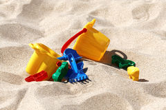 Plastic colored toys in the sand Stock Images