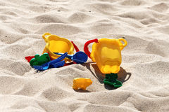 Plastic colored toys in the sand Royalty Free Stock Photo