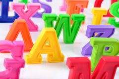 Plastic colorful alphabet letters close up on a white Stock Images