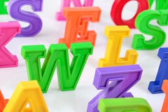 Plastic colorful alphabet letters close up on a white Stock Photo
