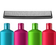 Plastic colorful bottles shampoo and black comb isolated Stock Image