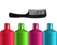 Plastic colorful bottles shampoo and black comb isolated Royalty Free Stock Image