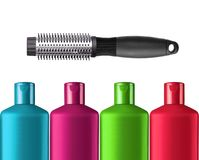 Plastic colorful bottles shampoo and black comb isolated Stock Photo