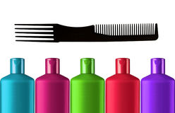 Plastic colorful bottles shampoo and black comb isolated Royalty Free Stock Photography