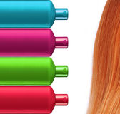Plastic colorful bottles shampoo and red hair isolated on white Stock Photography