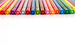Plastic colorful pens in row Royalty Free Stock Photo