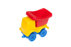 Plastic colorful toy truck, isolated over white background Royalty Free Stock Image