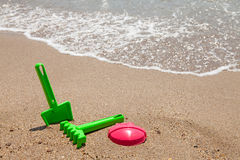 Plastic colorful toys at the beach Stock Photo
