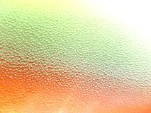 Plastic granules with orange, green and yellow colors, textured background Stock Photography