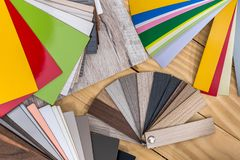 Plastic colour swatches for furniture on wooden background.  stock photos