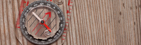 Plastic compass over a wooden background Stock Images