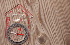 Plastic compass over a wooden background Stock Photos
