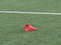 Plastic cone on painted white line of soccer field. Football green Royalty Free Stock Photography
