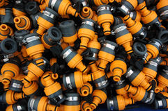 Manufactured Plastic connector objects. Orange and black hose connectors Stock Images