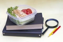 Plastic container, lunchbox with school lunch on a yellow background.  stock photos