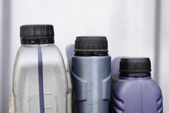 Plastic container for motor oil, car parts royalty free stock photo