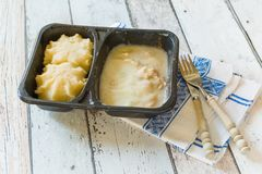 TV dinner with mashed potatoes. Plastic container with unhealthy and unappealing tv dinner Royalty Free Stock Photography