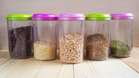 Plastic containers with cereals. Home storage products. Plastic containers with cereals. Home storage products stock image