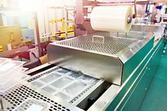 Plastic containers on conveyor at food factory for packing royalty free stock photography