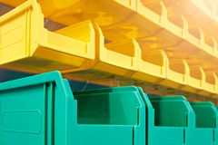 Plastic containers on the modern warehouse for piece small storage of goods. stock photography