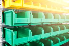 Plastic containers on the modern warehouse for piece small storage of goods. royalty free stock photography