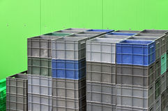 Plastic containers for storage and transportation of products. Plastic containers for storage and transportation of products on the background of green wall of Stock Photo