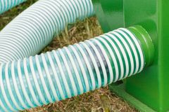 Plastic corrugated pipes in agricultural machine, technology concept stock images