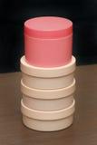 Plastic cream containers Stock Photo