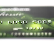 Plastic credit card. Fragment of a plastic credit card on a white background Royalty Free Stock Photography
