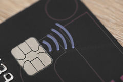Plastic Credit card with contactless symbol electronic chip and money Stock Photo