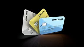 Plastic Credit Cards Bank Name. A backing 3d illustration of three credit cards of golden, blue, and grey colors, offering the electronic payment services of Royalty Free Stock Photography