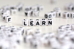 Plastic cubes letters forming the word learn on white background Stock Photography