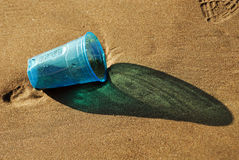 Plastic cup on the beach Stock Image