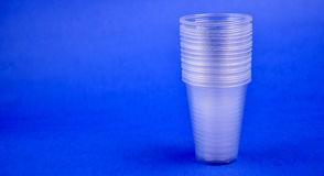 Plastic cup. On blue background stock images