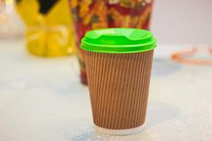 Plastic cup of coffee and drinking. Table background royalty free stock photo