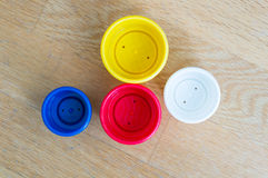 Plastic cup. Colorful plastic toy cups on wood stock image