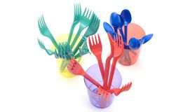 Plastic cup with forks stock photography