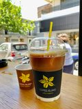 Plastic cup of iced coffee. Rodos, Greece - MAY 18, 2019: Cup of iced coffee in Coffee Island coffee shop, one of the best coffee makers in Rodos, Greece stock image