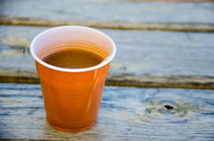 Plastic cup of instant coffee Stock Image