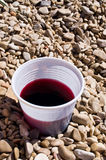 Plastic cup with red liquid Royalty Free Stock Photo