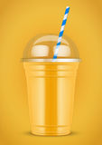 Plastic cup with smoothie and tube. Stock Photos