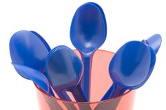 Plastic cup with spoon. Object on white - kitchen utensil - plastic cup with spoon royalty free stock photo